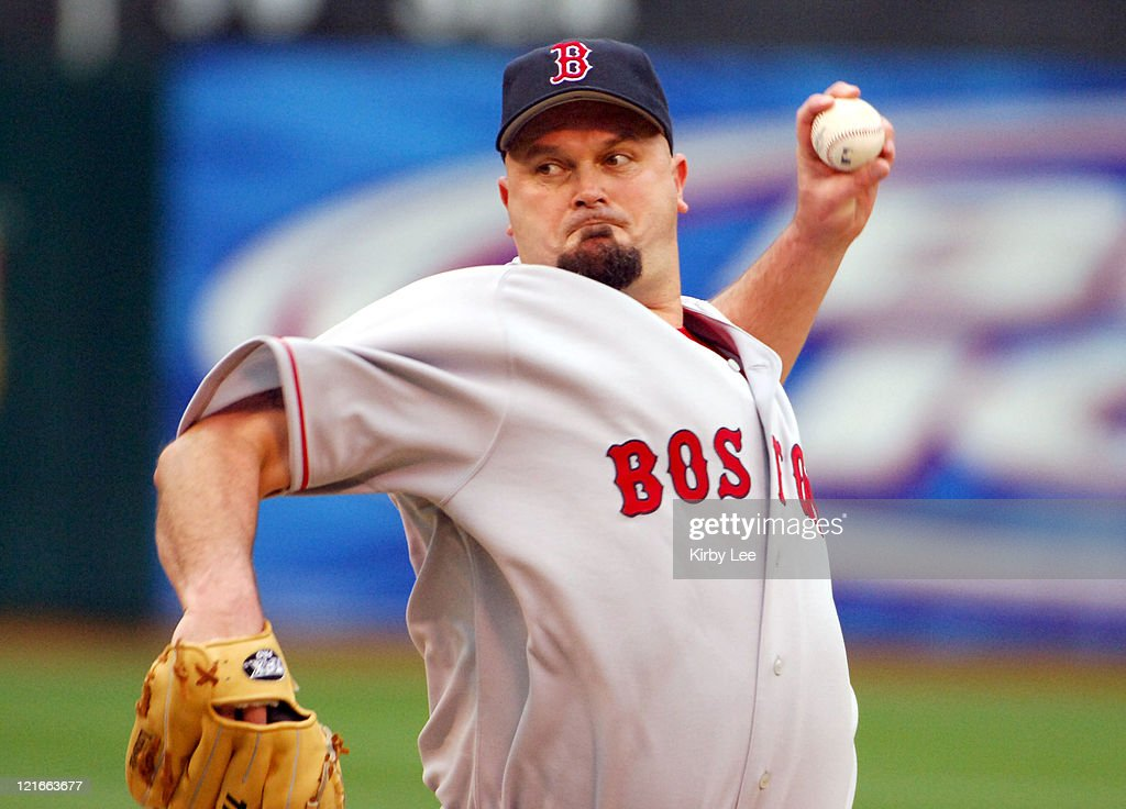Boston Red Sox starter <a gi-track='captionPersonalityLinkClicked' href=/galleries/search?phrase=David+Wells+-+Baseball+Player&family=editorial&specificpeople=202481 ng-click='$event.stopPropagation()'>David Wells</a> pitches during 13-6 loss to the Oakland Athletics at McAfee Coliseum in Oakland, Calif. on Wednesday, May 18, 2005. Wells (2-4) pitched 1 1/3 innings, allowing seven earned runs and nine hits.