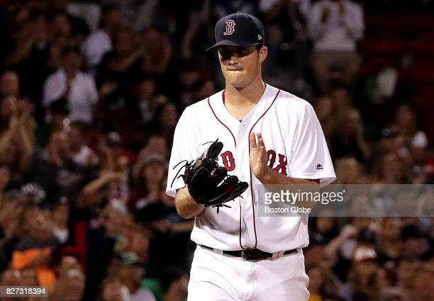 Boston Red Sox starting pitcher Drew Pomeranz claps in appreciation of the double play that got him the third out to end the fifth inning The Boston...