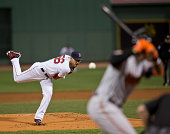 Boston Red Sox starting pitcher Joe Kelly delivers a pitch to Baltimore Orioles Adam Jones during first inning action at Fenway Park on Monday...