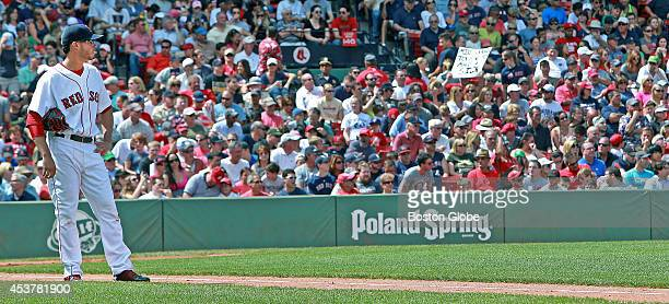 Boston Red Sox starting pitcher Joe Kelly stops and watches as the umpires get together and discussed a play during the second inning The Boston Red...