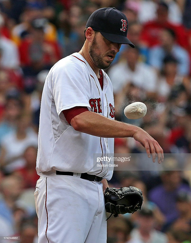 Boston Red Sox starting pitcher John Lackey (#41) dueled New York Yankees starting pitcher Hiroki Kuroda (#18) but came out on the losing end as the Boston Red Sox took on the New York Yankees in game two of a three-game series at Fenway Park.
