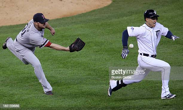 Boston Red Sox starting pitcher Jon Lester initially bobbled the bunt laid down by Detroit Tigers shortstop Jose Iglesias but recovered and scooped...