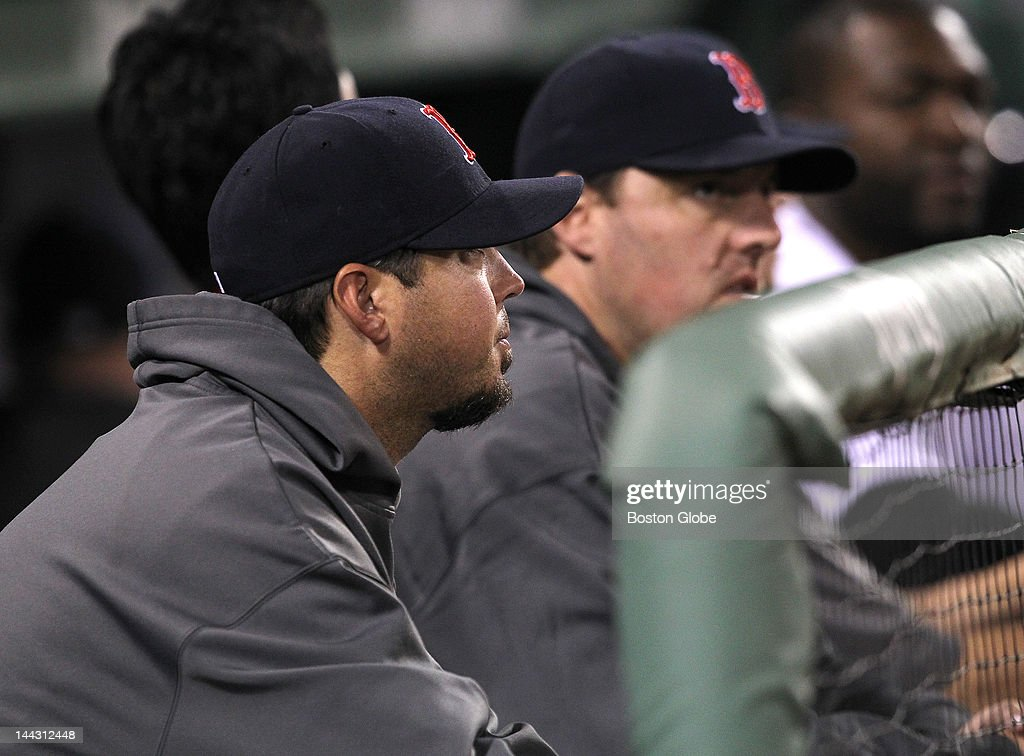 Boston Red Sox starting pitcher Josh Beckett (#19) and John Lackey watch from the dugout. The Boston Red Sox took on the Cleveland Indians at Fenway Park.