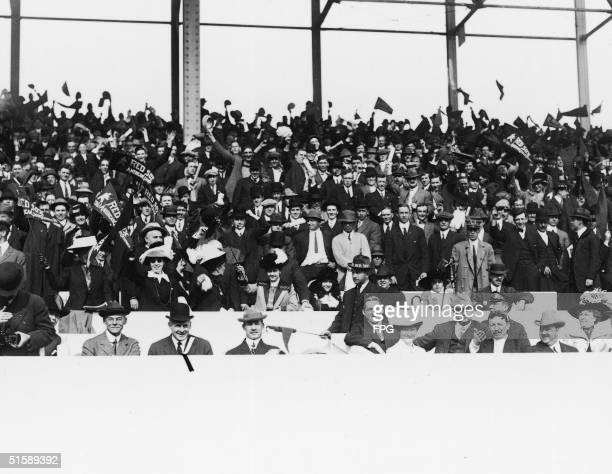 Boston Red Sox supporters in the stands at Fenway Park prior to the start of the World Series Boston Massachusetts October 1912 Some spectators wave...