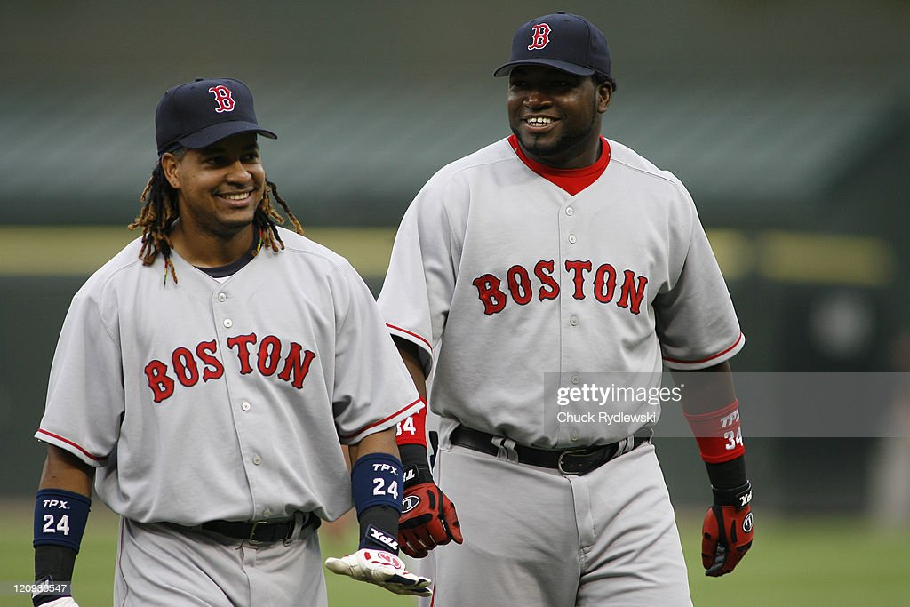 Boston Red Sox' teammates, Manny Ramirez and <a gi-track='captionPersonalityLinkClicked' href=/galleries/search?phrase=David+Ortiz&family=editorial&specificpeople=175825 ng-click='$event.stopPropagation()'>David Ortiz</a>, enjoy a laugh prior to the game against the Chicago White Sox July 7, 2006 at U.S. Cellular Field in Chicago, Illinois. The Red Sox would defeat the White Sox 7-2.