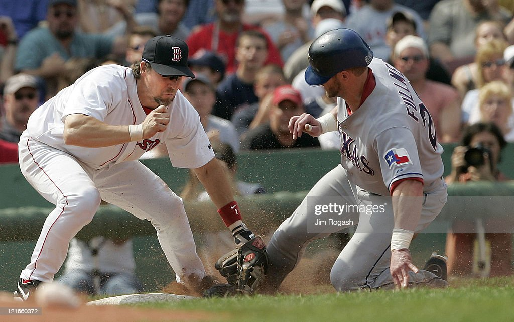 Boston Red Sox third baseman <a gi-track='captionPersonalityLinkClicked' href=/galleries/search?phrase=Bill+Mueller&family=editorial&specificpeople=194917 ng-click='$event.stopPropagation()'>Bill Mueller</a>, left, slaps a tag on a sliding Texas Rangers base runner <a gi-track='captionPersonalityLinkClicked' href=/galleries/search?phrase=Brad+Fullmer&family=editorial&specificpeople=220658 ng-click='$event.stopPropagation()'>Brad Fullmer</a> for the out. The Rangers beat the Red Sox 6-5 at Fenway Park in Boston Massachusetts on July 11, 2004.