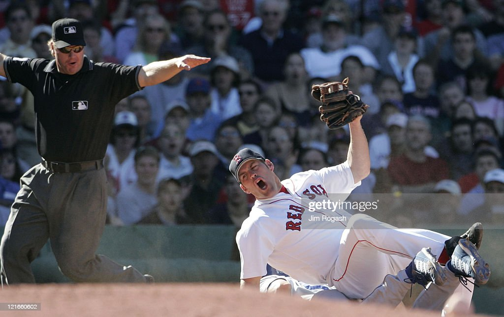 Boston Red Sox third baseman Kevin Youkilis reacts to q call by third base umpire Brian Runge in favor of Los Angeles Dodgers' Shawn Green at Fenway Park in Boston, Massachusetts on June 12, 2004. Youkilis felt Green was out on a pickoff attempt.