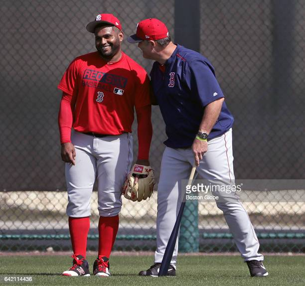 Boston Red Sox third baseman Pablo Sandoval and Boston Red Sox manager John Farrell share a laugh in the outfield during an informal workout for...