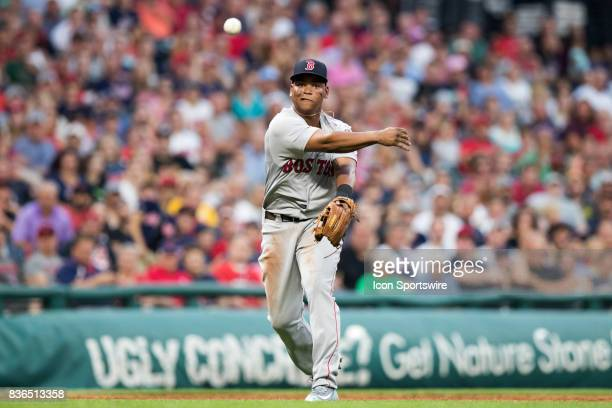 Boston Red Sox third baseman Rafael Devers throws to first base for an out after making a diving stop during the third inning of the Major League...