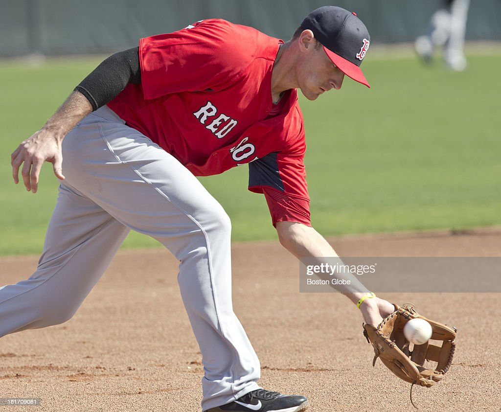 Boston Red Sox third baseman Will Middlebrooks fields a ground ball. Day two of spring training at the Red Sox training facilities at JetBlue Park on Wednesday, Feb. 13, 2013.