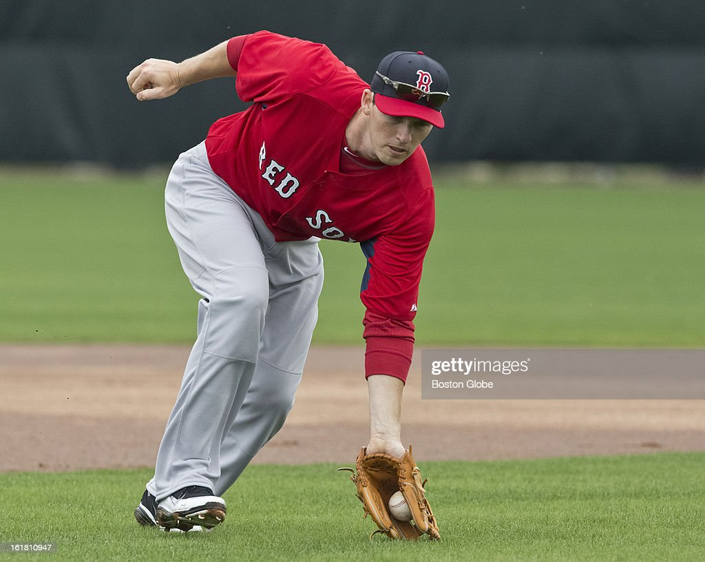 Boston Red Sox third baseman Will Middlebrooks fields a ground ball during the first full squad team workout. Day four of spring training at the Red Sox training facilities at JetBlue Park on Friday, Feb. 15, 2013.