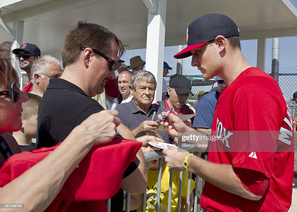 Boston Red Sox third baseman Will Middlebrooks signs his autograph after practice. Day two of spring training at the Red Sox training facilities at JetBlue Park on Wednesday, Feb. 13, 2013.