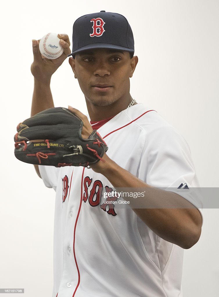 Boston Red Sox top prospect Xander Bogaerts poses with a ball and glove during media photo day while the Boston Red Sox hold spring training at JetBlue Park on Sunday, Feb. 17, 2013.