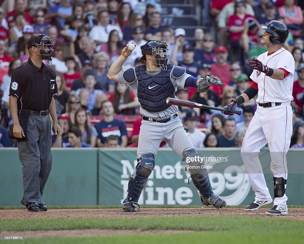 Boston Red Sox Will Middlebrooks is called out on strikes by home plate umpire Vic Carapazza as Seattle Mariners catcher Mike Zunino throws the ball back to the pitcher during ninth inning action at Fenway Park on Sunday, August 24, 2014.