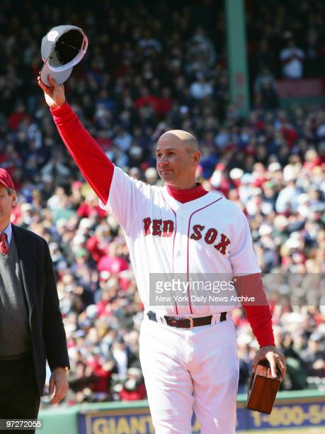 Boston Red Sox's Manager Terry Francona waves to cheering fans as he receives his 2004 World Series Championship ring during ceremonies before the...