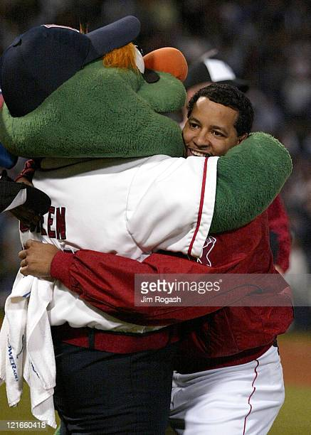 Boston Red Sox's Manny Ramirez is hugged by Wally The Green Monster in celebration after the Red Sox clinched a playoff spot in the American League...