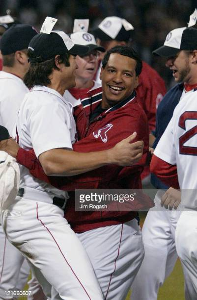 Boston Red Sox's Manny Ramirez right and Johnny Damon hug in celebration after the Red Sox clinched a playoff spot in the American League after...