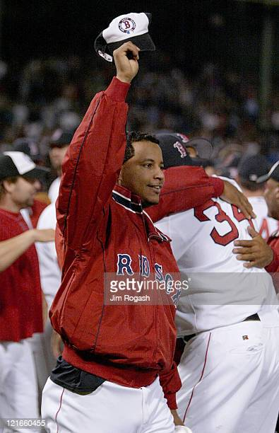 Boston Red Sox's Manny Ramirez tips his playoff hat to the crowd in celebration after the Red Sox clinched a playoff spot in the American League...