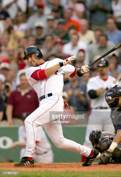 Boston Red Sox's Nomar Garciaparra hits a single during a game against the San Diego Padres in Fenway Park June 9 2004