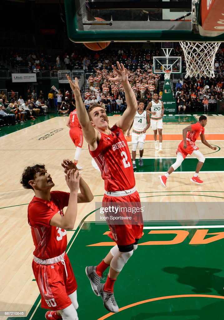 Boston U forward Tyler Scanlon (2) rebounds during a college basketball game between the Boston University Terriers and the University of Miami Hurricanes on December 5, 2017 at the Watsco Center, Coral Gables, Florida. Miami defeated Boston U