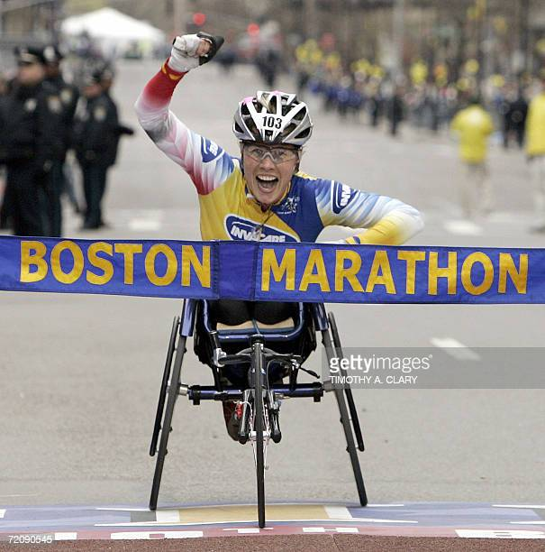 Edith Hunkeler of Switzerland crosses the finish line to win the women's wheelchair division of the 110th Boston Marathon in Boston Massachusetts 17...