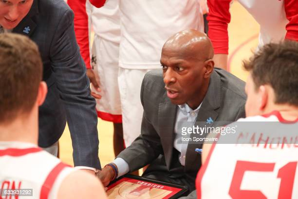 Boston University Terrier head coach Joe Jones sketches a play during a timeout in the first half of the game between the Lafayette College Leopards...