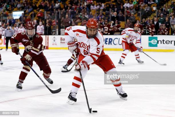 Boston University Terriers defenseman Chad Krys chased by Boston College Eagles defenseman Jesper Mattila during a Hockey East semifinal between the...