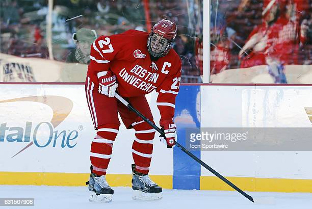 Boston University Terriers defenseman Doyle Somerby checks with his defensive pair during a Frozen Fenway NCAA Men's Division 1 hockey game between...