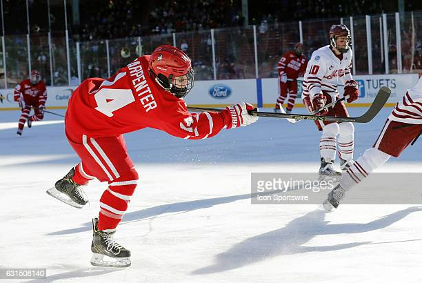 Boston University Terriers forward Bobo Carpenter follows through on a shot during a Frozen Fenway NCAA Men's Division 1 hockey game between the...