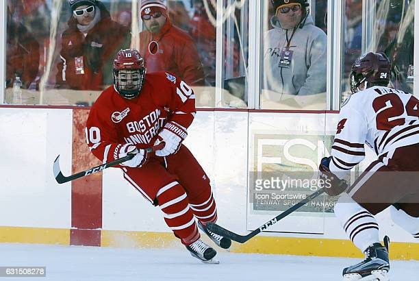Boston University Terriers forward Gabriel Chabot follows the puck into the offensive half of the ice during a Frozen Fenway NCAA Men's Division 1...