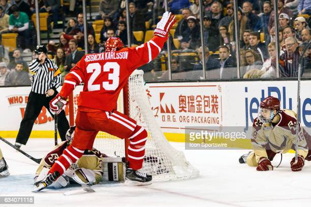 Boston University Terriers forward Jakob Forsbacka Karlsson celebrates a goal on Boston College Eagles goaltender Joseph Woll during the first period...