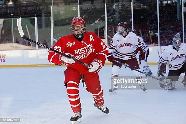 Boston University Terriers forward Jakob Forsbacka Karlsson chases down a puck along the boards during a Frozen Fenway NCAA Men's Division 1 hockey...