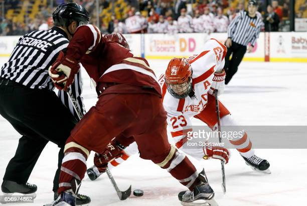 Boston University Terriers forward Jakob Forsbacka Karlsson faces off with Boston College Eagles forward Graham McPhee during a Hockey East semifinal...