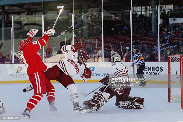 Boston University Terriers forward Nikolas Olsson checks UMass Minutemen defenseman Shane Bear in front of UMass Minutemen goaltender Ryan Wischow...