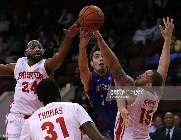 Boston University Terriers forward Travis Robinson guard/forward Malik Thomas and forward Dom Morris combine on defense to shut the door on American...