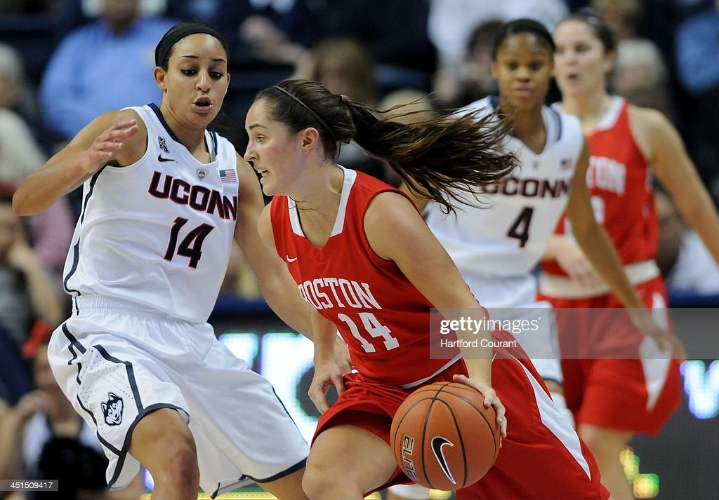 Boston University Terriers guard Courtney Latham (14) drives around Connecticut Huskies guard Bria Hartley (14) during the first half at Gampel Pavilion in Storrs, Conn., Friday, Nov. 22, 2013. UConn defeated Boston U., 96-38.