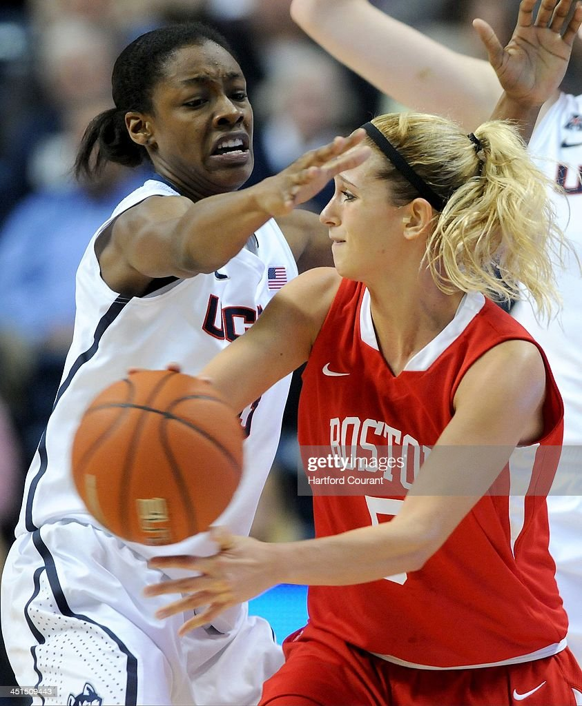 Boston University Terriers guard Melissa Gallo (5) tries to find a teammate to pass to as Connecticut Huskies guard Brianna Banks (13) defends during the first half at Gampel Pavilion in Storrs, Conn., Friday, Nov. 22, 2013. UConn defeated Boston U., 96-38.