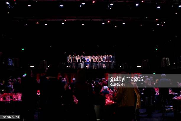 Boston University's Fine Arts Undergraduate Performers sing to the crowd at the Boston University Theatre Center Ribbon Cutting event on Wednesday...