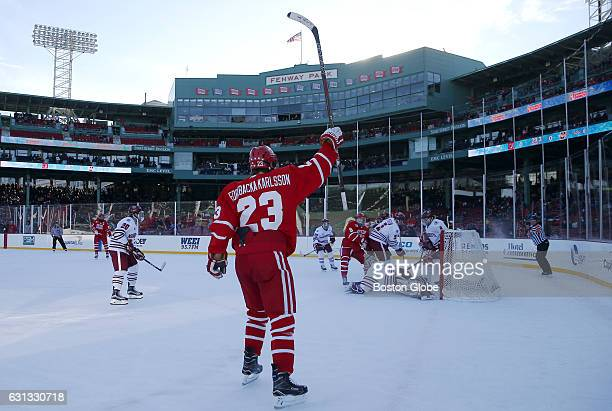 Boston University's Jakob Forsbacka Karlsson celebrates a goal against UMass during the first period of play at Fenway Park in Boston on Jan 8 2017