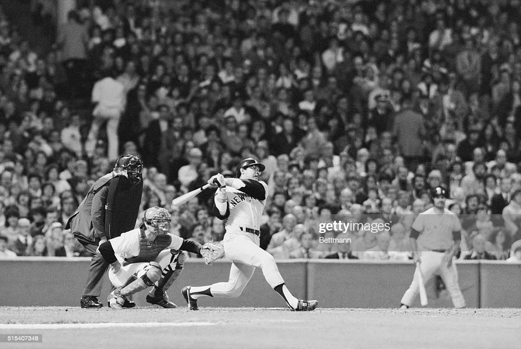 Yankees' Reggie Jackson connects for a 3-run homer into the right field stands, 2nd inning, night game, Fenway Park. He drove in Thurman Munson and Mickey Rivers. Bosox Carlton Fisk (C) and Home Plate Umpire Marty Springstead (L). The Yankees belted the Bosox, 13-2.