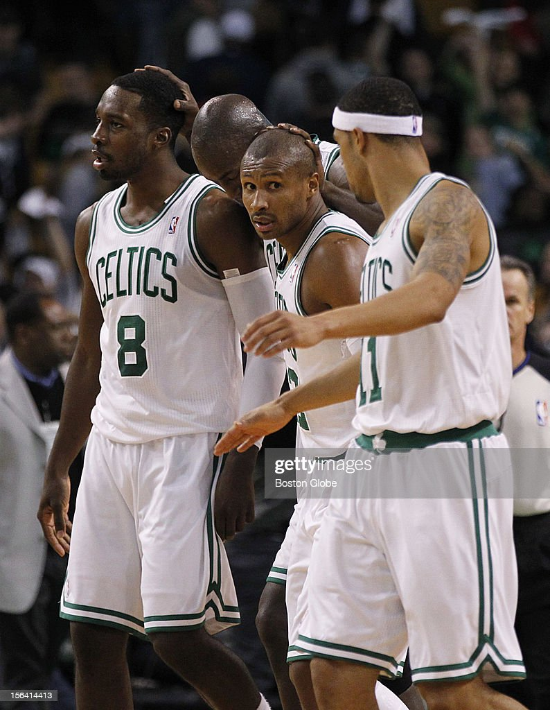 BostonCeltics players Jeff Green (#8), Kevin Garnett (#5) and Leandro Barbosa (#12) embrace after beating the Utah Jazz 98-93 at TD Garden in a regular season NBA game in Boston, Mass. on Wednesday, Nov. 14, 2012. In the foreground is guard Courtney Lee (#11).