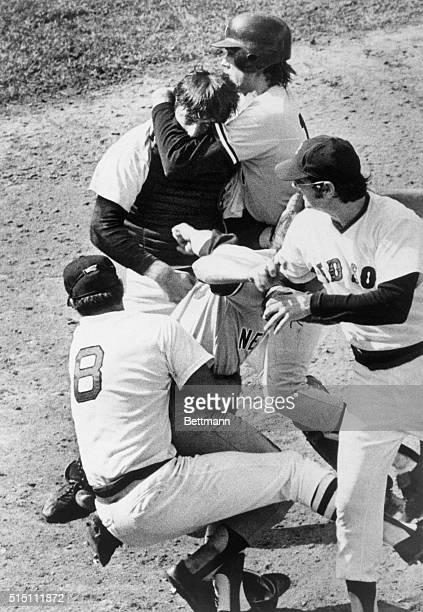 Boston's Carl Yastrzemski tackles Yankees' Thurman Munson Boston's John Curtin rushes in Behind them Yankees' Gene Michael has Boston's catcher...