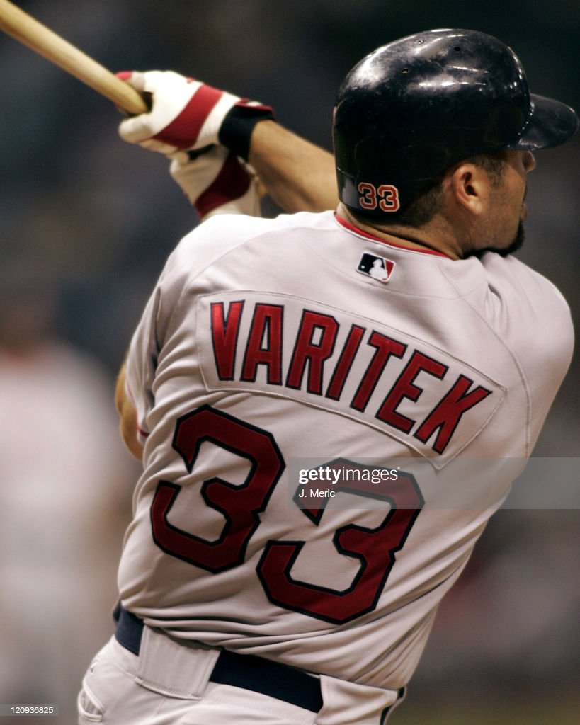 Boston's <a gi-track='captionPersonalityLinkClicked' href=/galleries/search?phrase=Jason+Varitek&family=editorial&specificpeople=171480 ng-click='$event.stopPropagation()'>Jason Varitek</a> connects on a pitch in Monday night's game against the Tampa Bay Devil Rays at Tropicana Field in St. Petersburg, Florida on July 25, 2005.