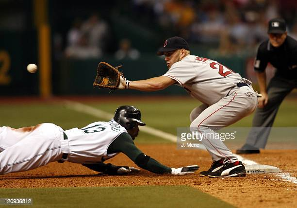 Boston's Kevin Youkilis prepares to take the throw as Tampa Bay's Carl Crawford slides safely back to first during Friday night's action at Tropicana...