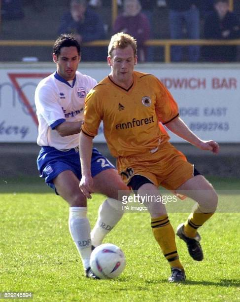 Boston's Simon Rusk and Andy Sambrook of Rushden in action during the Nationwide Division 3 match at York Street Stadium Boston THIS PICTURE CAN ONLY...