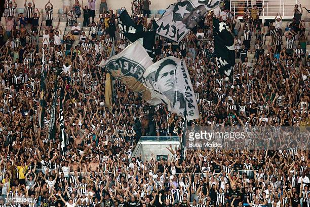 Botafogo fans celebrate a victory after the match between Botafogo and Atletico MG as part of Brazilian Cup 2013 at Maracana Stadium on August 22...