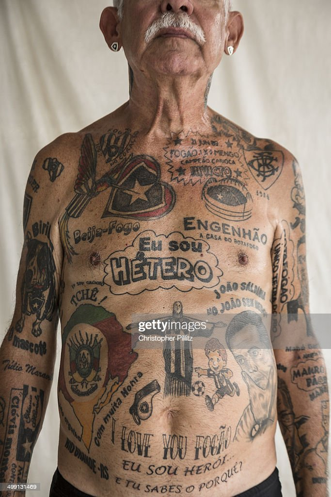 Former Brazilian military officer Delneri Martina Viana, 68 has been a life long supporter, some would say an irreperable, impassioned fanatic of Rio de Janeiro's Botafogo FC. Ever since his departure form his military life he set upon decorating every centimetre of skin with tattoos mostly related to his love and obsession for 'his ' Botafogo team. His house and all its possessions have Botafogo related memorabilia, from plates, to bed sheets, watches, clocks, even the hub caps of his car contain the emblematic white star of Botafogo. His entire 'raison d'etre' in life is about his obsession for his team. Bangu, Rio de Janeiro.