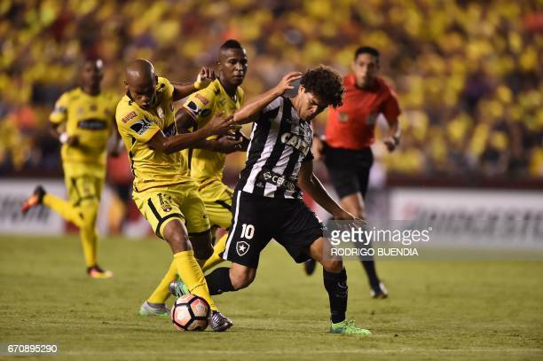 Botafogo's Camilo vies for the ball with Barcelona's Ely Esterilla during their 2017 Copa Libertadores football match at the Monumental stadium in...