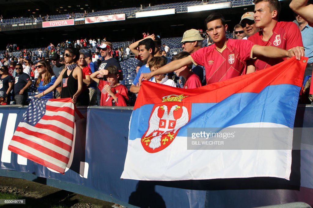 Both American and Serbian flags were displayed by fans during a MLS friendly match at Qualcomm Stadium in San Diego, California on January 29, 2017. / AFP / Bill Wechter