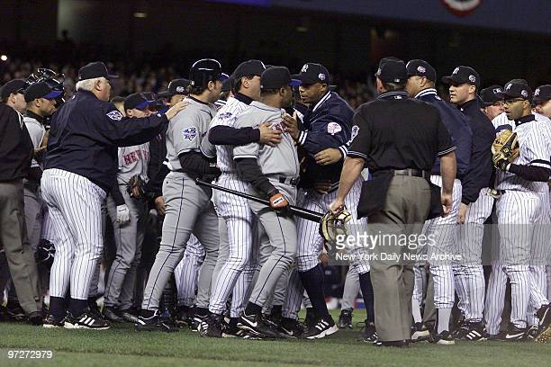 Both benches clear out after New York Yankees' starting pitcher Roger Clemens threw New York Mets' Mike Piazza's broken bat at him during the first...